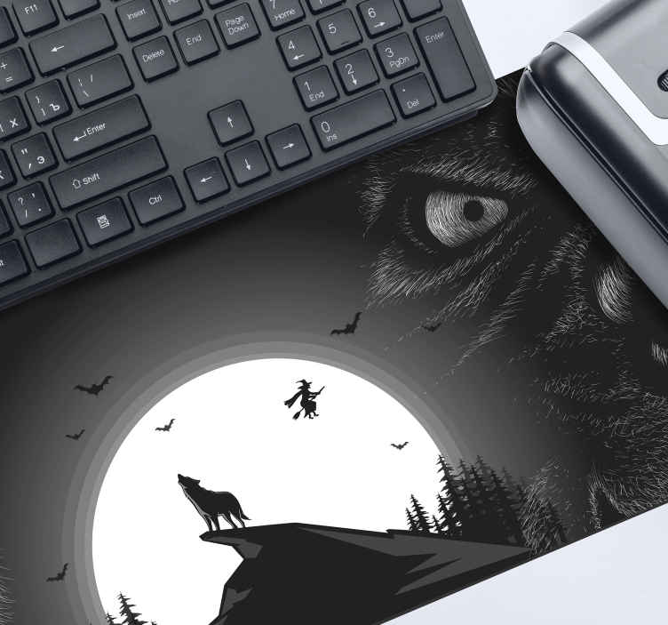 TenStickers. Howling Wolf gaming vinyl mouse pad. Howling wolf gaming mouse pad featured with flying bats, wolf on mountain top etc on a black background. It is made from high quality material.