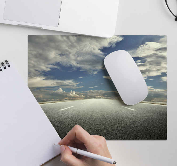 TenStickers. Highway original vinyl mouse pad. Buy our thematic mouse mat with the design of a highway with cloudy sky. It is made of high quality material and easy to maintain.