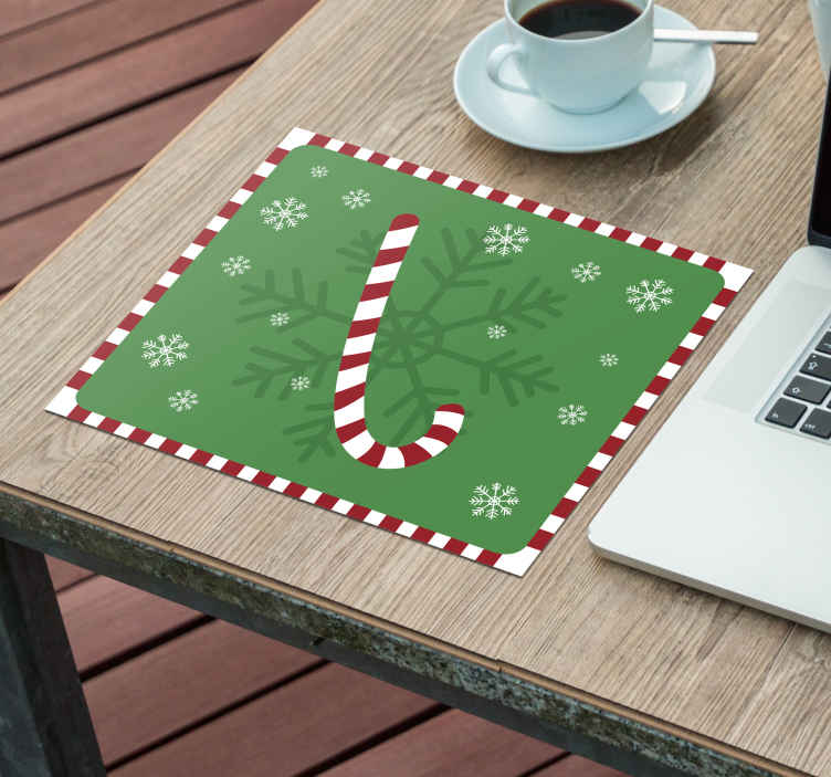 TenStickers. Candy Cane Christmas mousepad. Fun and unique Christmas snow mousepad which features a classic cartoon candy cane backed by a giant snowflake. High quality materials.