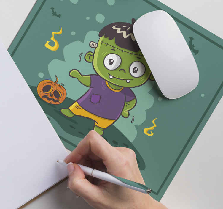 TenStickers. Mini monster Frankenstein mouse pad.  Mini monster Frankenstein mouse pad design. The design contains ghost, bat, little boy monster, pumpkin, all on green background.