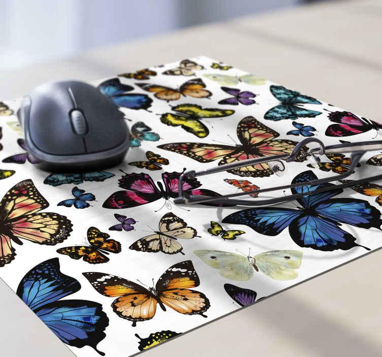 Tenstickers. Kaunis ja värikäs perhosia perhoshiirimatto. Kaunis ja värikäs perhoset -hiirimatto, jotta työaikasi tietokoneella olisi vähemmän stressaavaa. Alkuperäinen kestävä ja helppo puhdistaa.