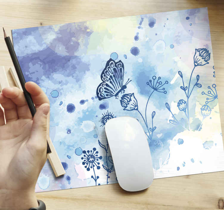 TenStickers. Floral draw and butterflies butterfly mouse mat. A blue abstract painted mouse pad design. The design also features with flowers with hanging butterflies. Available in different sizes and of quality.