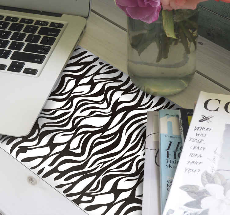 TenStickers. Swirl Zebra mouse mat. Zebra mouse pad which features an amazing abstract zebra print pattern which looks like stunning swirls. The design is coloured in black and white.