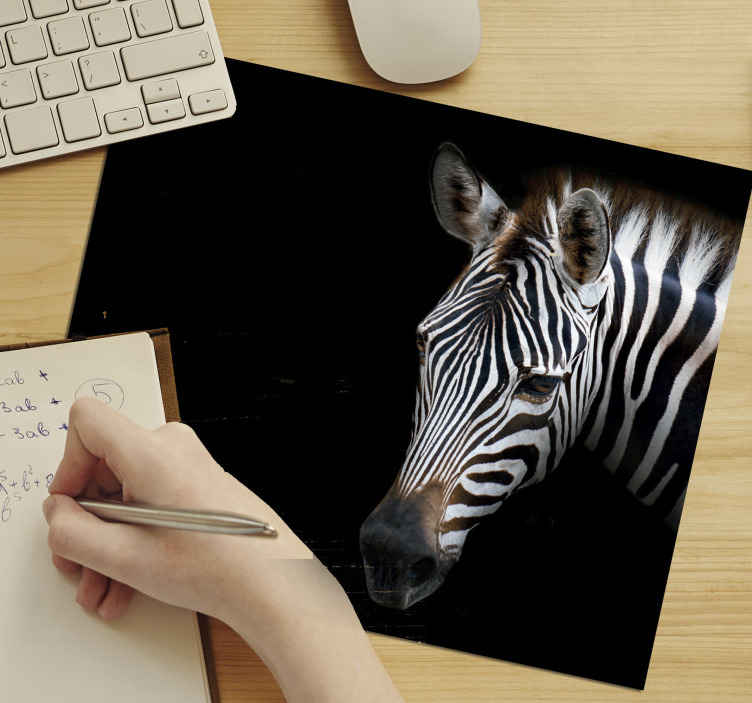 TenStickers. Black and White Zebra mouse mat. Zebra mouse mat which  features a stunning image of a zebra with a dark black background. The zebra looks very realistic.