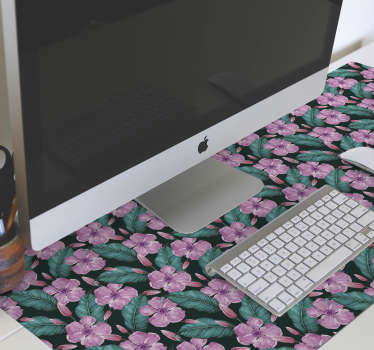 Bring a touch of nature to your desk decor with this wonderful floral mouse pad with a pattern of pink tropical flowers surrounded by green leaves.