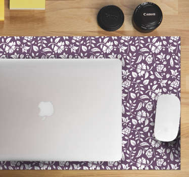 Color your desk and at the same time get a better experience while using your computer with this floral mouse pad with a pattern of white flowers.