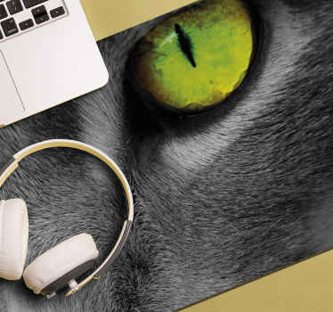 Cat mouse pad which features a close up image of a cat's face. The cat's eye is an unbelievable shade of green! High quality.