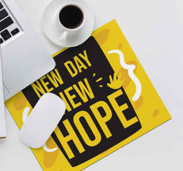 Start everyday been reminded with your quote mouse mat that is it is a ''New day new hope''.  The design is created on a yellow and black background.