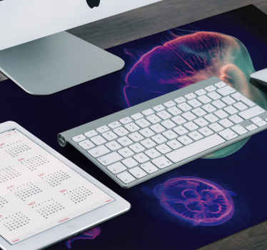 A multi coloured trendy mouse pad product with jellyfish design to decorate your mouse space and enable use your mouse efficiently.