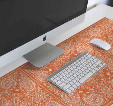 Decorative paisley patterned mouse pad  designed on an orange background. It is easy to maintain and made of good quality.
