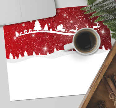 Christmas mousepad with a design that illustrate stars, snow, waves, Christmas tree and Santa. On the design is seen Santa clause riding on a cart.