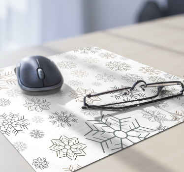 Christmas snowflakes pattern mouse mat for your computer mouse space. The design is created with lovely ornamental prints that depicts snow fall.