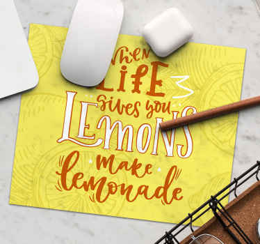 Lemon mouse pad which features the famous text 'When life gives you lemons, make lemonade' surrounded by drawings of lemons.