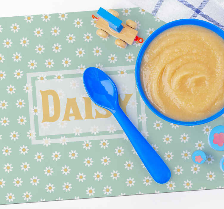 TenStickers. Kids daisy pattern floral vinyl placemats. Discover those children placemats and save your tables from being ruined. The design of daisies will beautifully accompany the name of your choice!