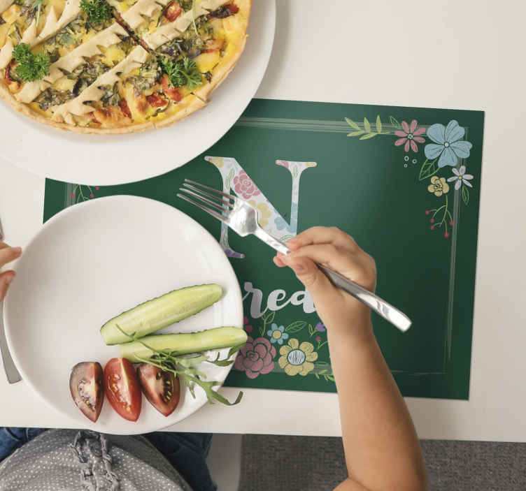 TenStickers. Green with flowers customisable name vinyl placemats. Ornamental personalized name place-mat design featured with beautiful flower design, it is customisable in any name required.
