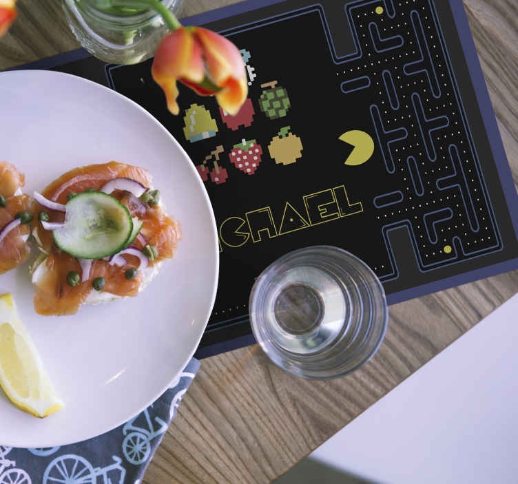 TenStickers. Pac Man game children vinyl placemats. Pac Man game children placemats to bring out that game smile on your kids as they dine on the table space. It is personalisable with any name.