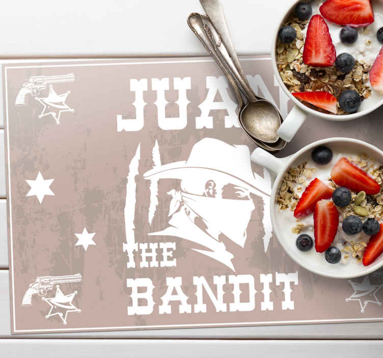 TenStickers. Bandit with name name vinyl placemats. Personalized name home place-mat with a light brown background featured with a bandit silhouette and other designs in white colour.