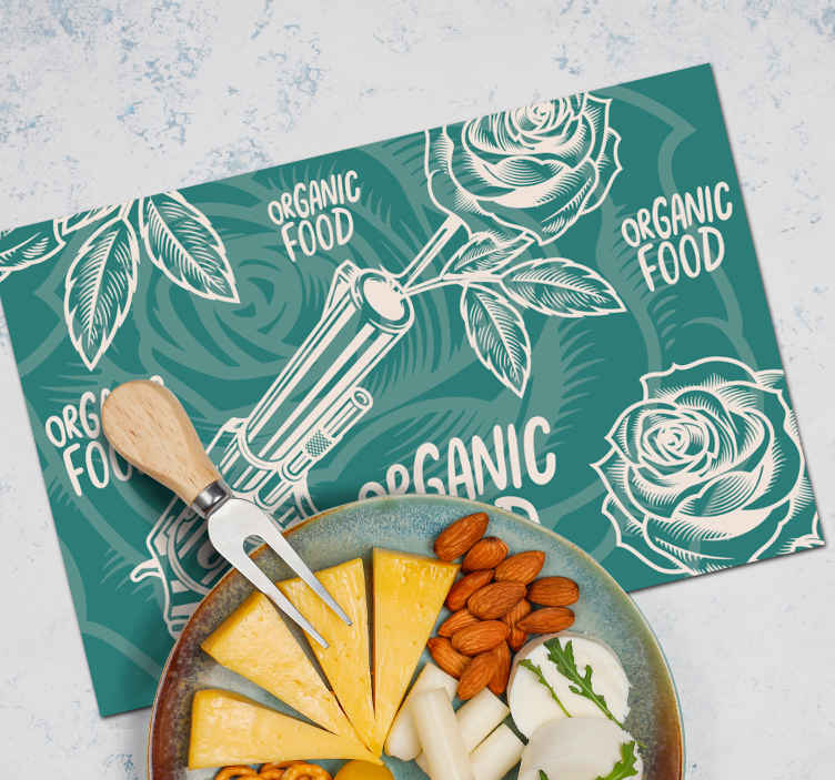 TenStickers. Revolver and Rose green vinyl placemats. Green coloured vinyl place-mat with the design of a revolver and  roses. It is made of good quality and easy to maintain.
