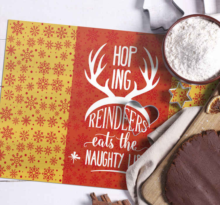 TenStickers. Reindeer Quote Christmas table mats. Christmas placemat which features the text 'Hoping reindeers eats the Naughty list' with a large pair of reindeer antlers.