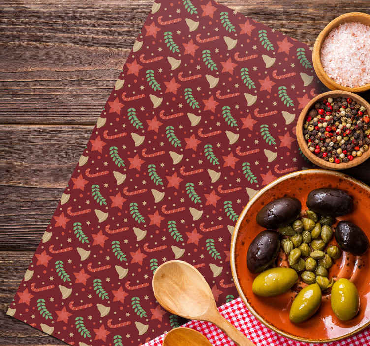 TenStickers. Red candy pattern Christmas vinyl placemats. A red coloured place-mat with design of Christmas candy, stars, ornamental leafs and bells. It is original and made with high quality material.