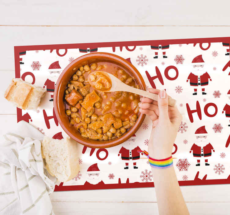 TenStickers. Santa Claus and HoHoHo pattern Christmas vinyl placemats. Featured Santa clause Christmas place mat design. The design also has the signature ho ho ho laughter  of santa printed all over it.