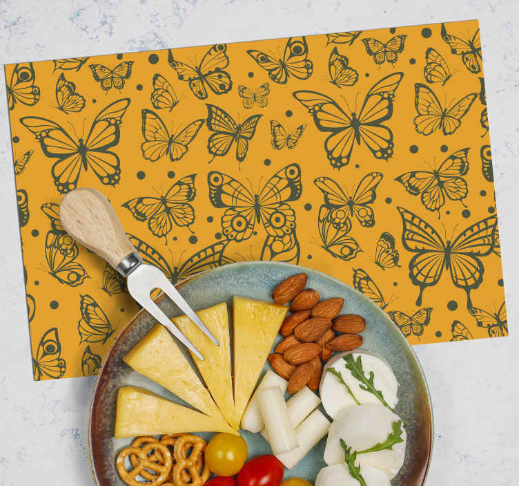 TenStickers. Orange and Black butterfly table mats. Butterfly placemat design which features a variety of stunning black butterflies on an orange background. Anti-bubble vinyl.