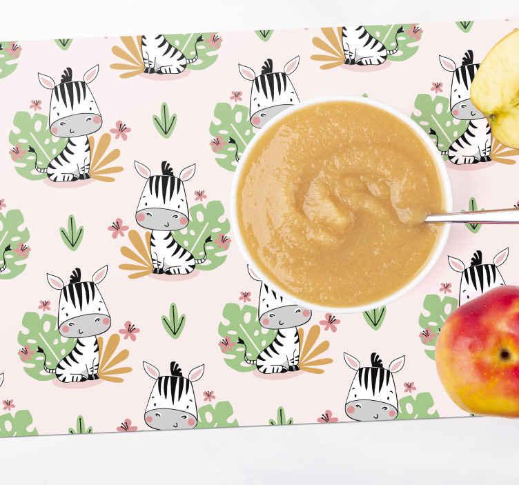 TENSTICKERS. 子供のための美しいシマウマゼブラプリントランチョンマット. 背景が黄色の子供用ランチョンマットと、赤ちゃんの食事の瞬間に喜びと優しさで満たされる木の葉が付いたデザインのシマウマ。