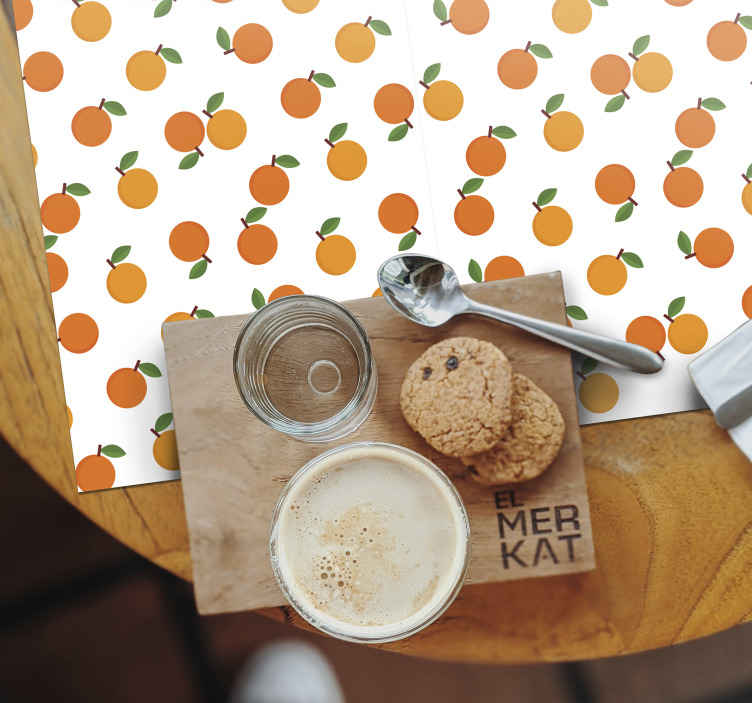TenStickers. Cartoon Oranges citrus table mat. Orange placemats which features a stunning pattern of lemons some of which are whole and some are cut in half. Discounts available.