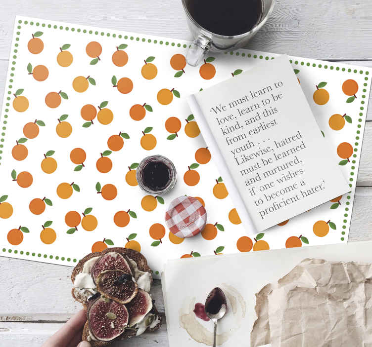 TenStickers. MANTEL Elegant oranges frame citrus table mat. Home placemat with a design of small oranges with green leaves on a white background that looks super elegant and classic, perfect for you.