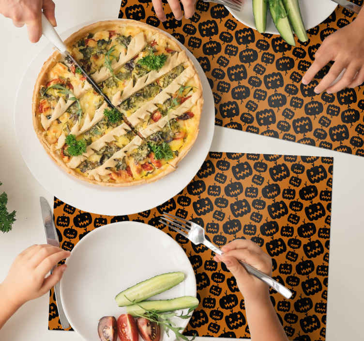TenStickers. Black and orange placemat. Black and orange colour place-mat featured with different scary pumpkin design, a suitable element to add Halloween vibe to your space.