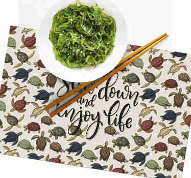 This quote vinyl placemat with a pattern of a variety of turtles and an inspiring quote in the center is perfect for you!