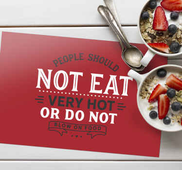 A placement with quote that says ''people should not eat very hot or do not blow on food''.  An ideal restaurant and home  place-mat.