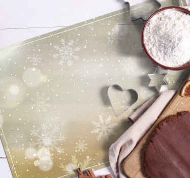The Christmas placemat features snowflakes of various and sizes on a silver and gold background. High quality materials used.