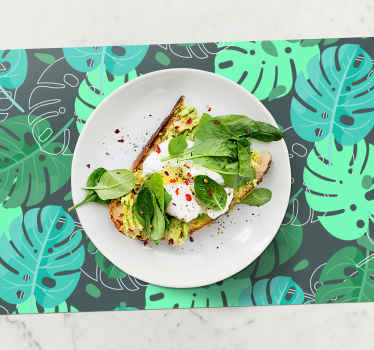 Purchase your original home placemat from us. The decorative table placemat has the design of tropical forest plant depicting Monstera Deliciosa.