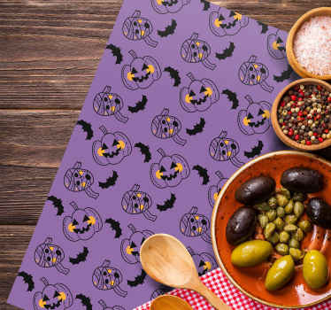other colored vinyl placemat featured with different scary mummies, bats and pumpkins on a violet background. Easy to clean.