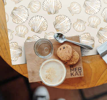 Beige placemats with seashells, perfect decoration for you house. It presents big and small seashells on a beige background. Made of a quality vinyl.