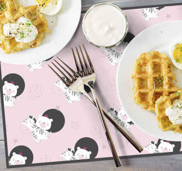 Animal placemat which features an adorable pattern of an image of a zebra and bear. High quality materials used. Custom made.