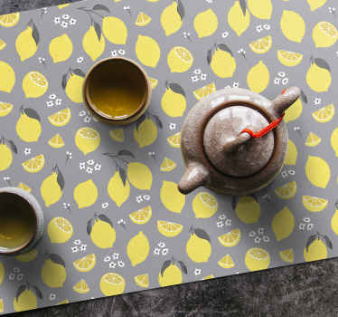 Grey placemat set which features a pattern of yellow lemons on a grey background surrounded by small white flowers. Custom made.