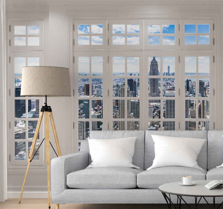 TenVinilo. Fotomural ventana a nueva york. Fotomural estupendo para tu salón, una ventana a nueva york en el que observarás los edificios más emblemáticos y las mejores vistas de la ciudad.