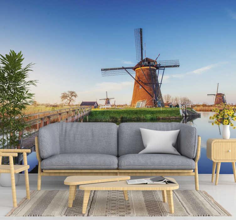 TenStickers. Mural de parede decorativo paisagem típica holandesa. Fotomural vinílico paisagem típica holandesa  de um moinho tipicamente holandês num belo dia de sol que ficará fantástico na sua sala de estar.