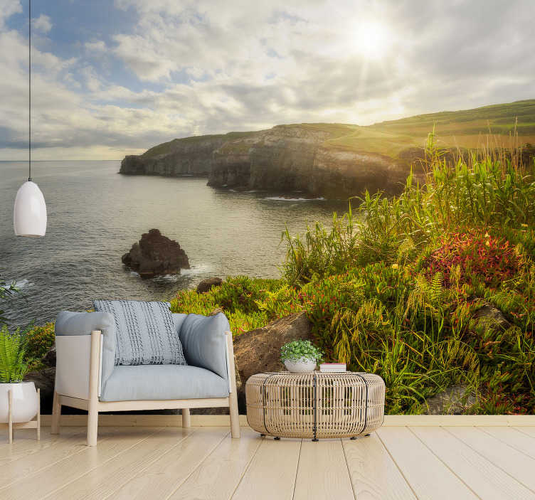 TenStickers. Azores at Dawn landscape wall mural. An Azores at Dawn landscape wall mural design that contains massive low rocks on the sea with the sun casting upon it in it fullness with the sky.