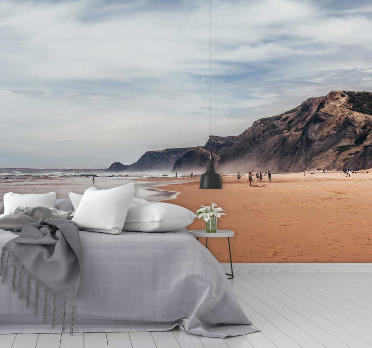 TenStickers. Gray Summer landscape wall mural. Design of a magnificent sea view with huge volcanic massive rock around with beautiful blue and white cloud above people with people enjoying the sea.