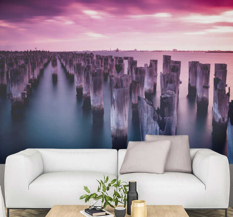 TenStickers. Pink Sunset landscape wall mural. This rosy sunset photo wallmural leaves a pink shine on some cut tribes in the water. The water is depicted so calmly that it will make you relax.