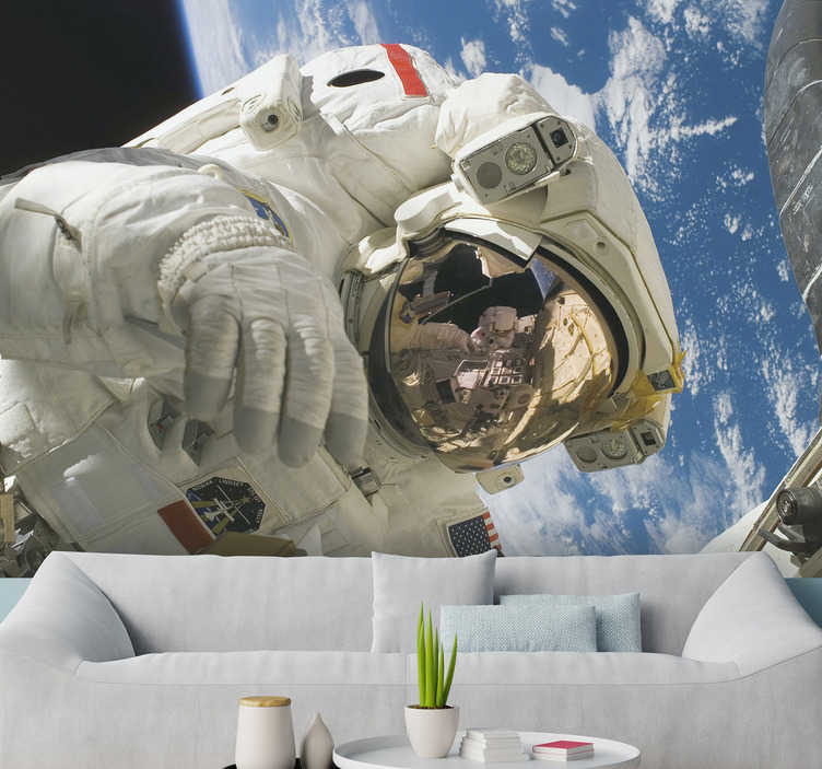 TenStickers. Austronaut with Earth Wall Murals for Bedrooms. This cool photo wallpaper shows a astronaut with the beautiful planet Earth in the background The bright colors of this image will impress you!