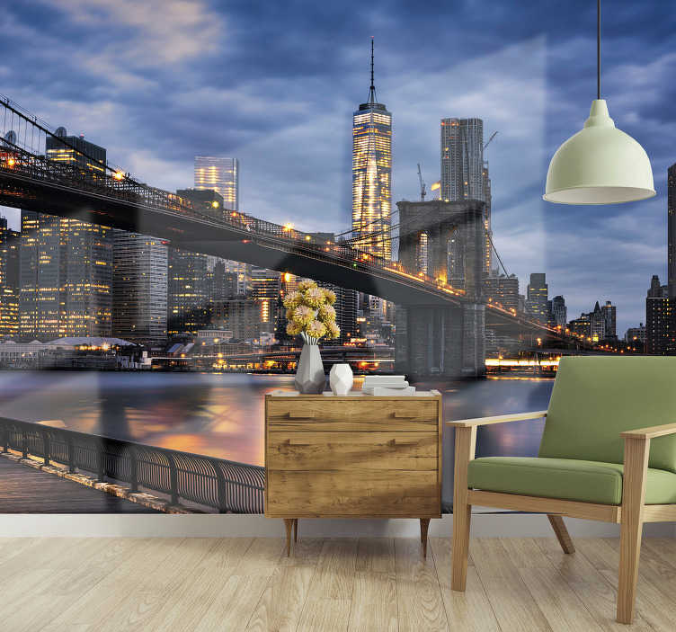 TenStickers. New York city lights skyline wall mural. Take a look at this beautiful evening mural of the New York high buildings and the bridge that gives a nice look with its lights.