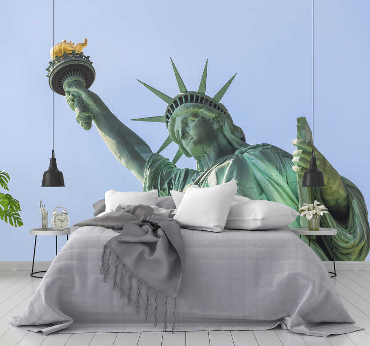 TenStickers. Statue of liberty on a sunny day New York wall mural. This New York wall mural with an image of the Statue of Liberty is perfect for you! Impress everyone who visits you with a unique and modern decor.
