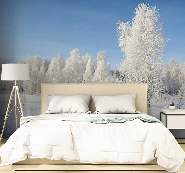 TenStickers. Winter trees coveredin snow Forest mural. Escape to your own perfect forest with this forest wall mural There's nothing more peaceful than gazing over the treetops of a forest, covered by snow
