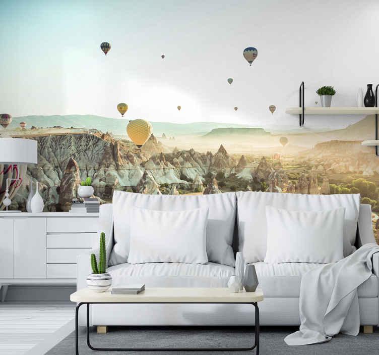 TenStickers. Fotomural de lugares Balões de ar quente da Capadócia. Um fotomural de parede de lugares muito bonito de vários balões de ar quente voando pacificamente acima da região de Capdócia.