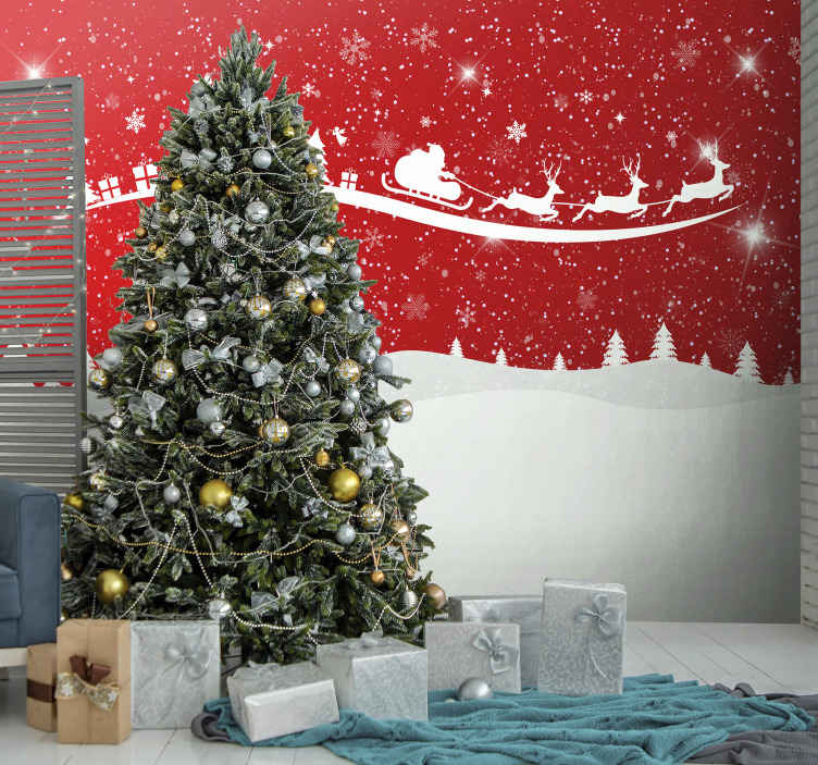 TenStickers. Christmas wave wall mural. Amazing Christmas red wallpaper photo featured with Santa riding on a cart pulled by reindeer and gift boxes packs. Easy to apply and of quality.