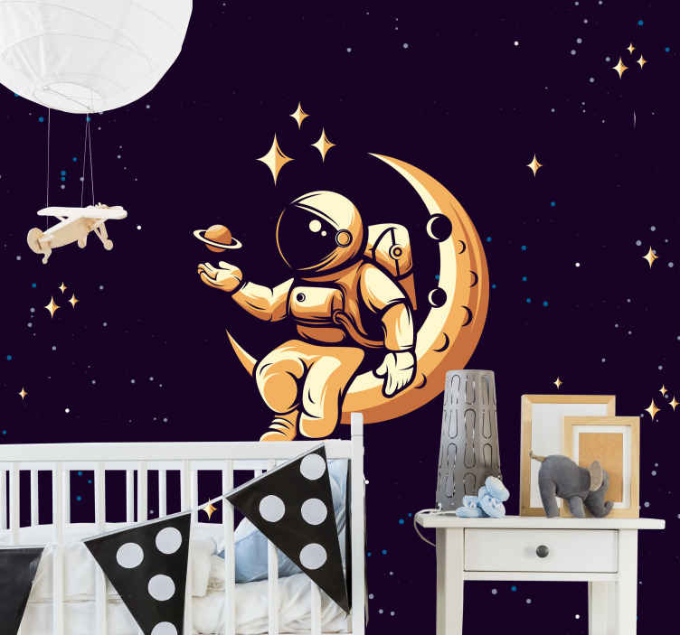 TenStickers. Space, stars and moon Dining Room Wall Mural. Large space wall mural containing the design of an astronaut sitting on the moon. It also features stars and space symbol on a deep blue background.